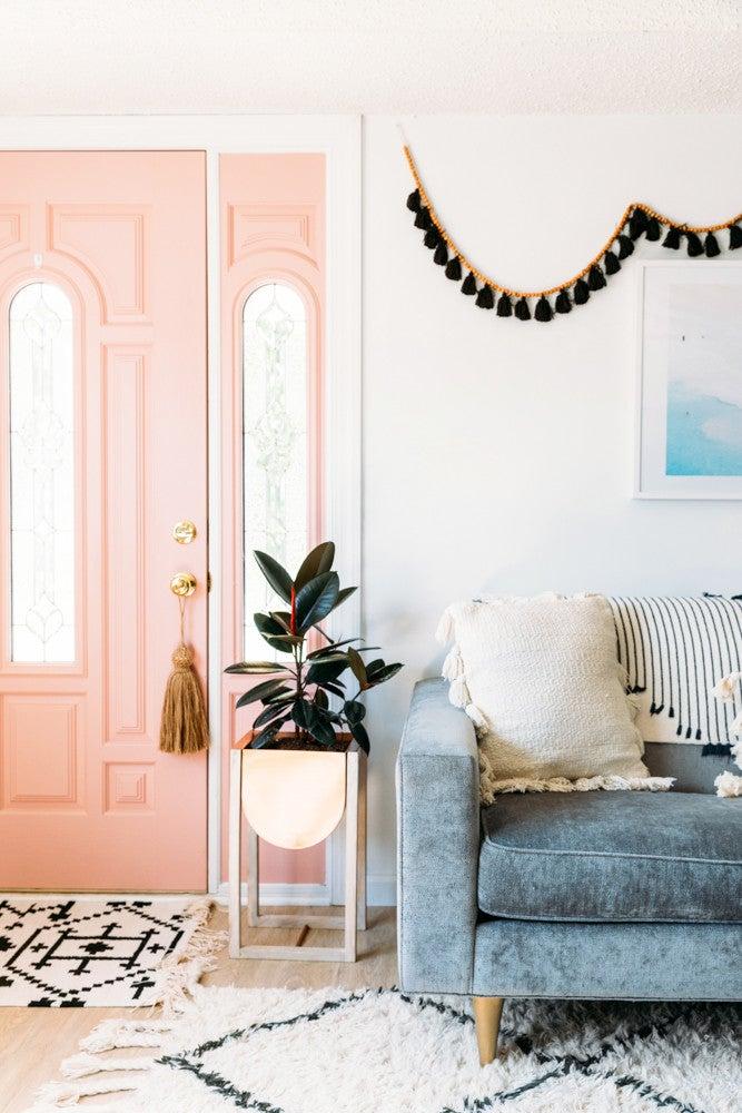 Cara Irwin Of Goldalamode Home Tour Pink Door Black Tassel Garland