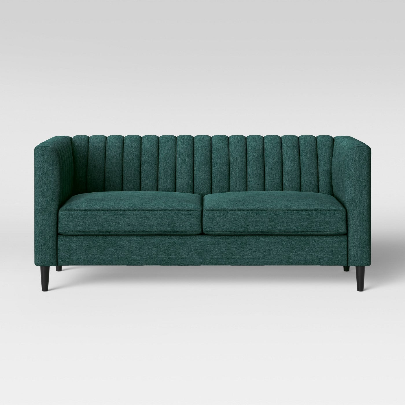 emerald green tufted couch