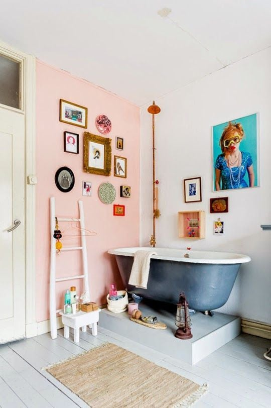 eclectic bathroom with pink wall