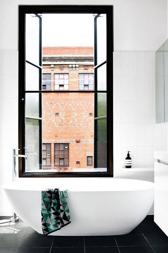 minimalist bathroom white bathroom with black window panes and tub