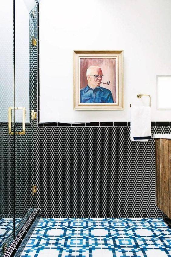 minimalist bathroom blue tiles and wall art in a bathroom