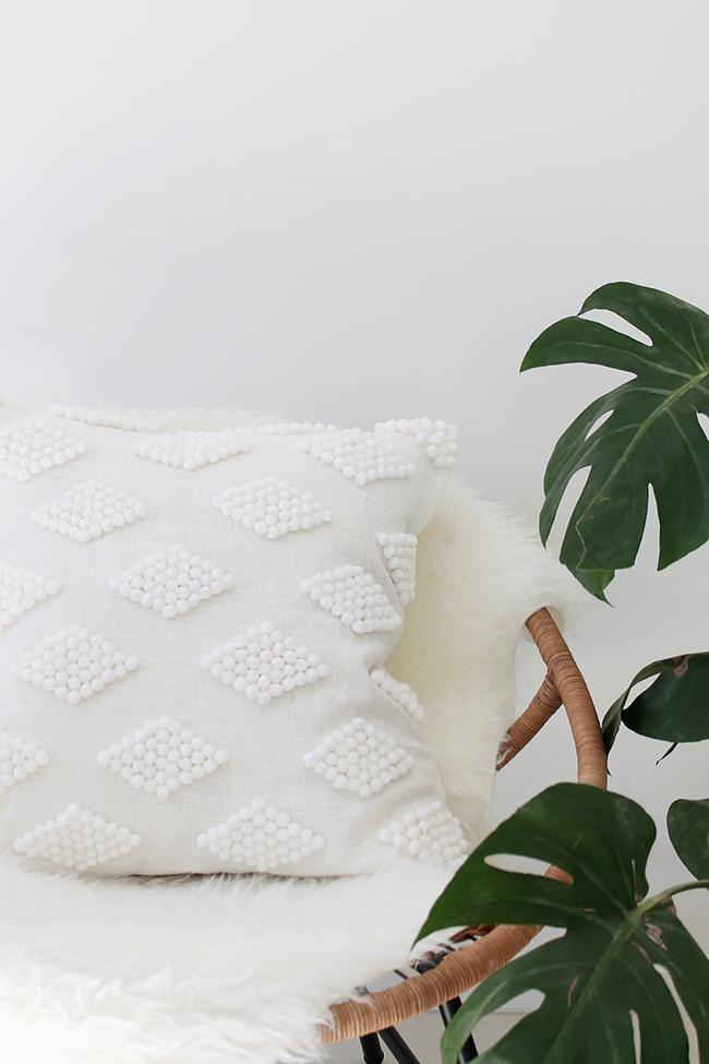 white pom pom throw pillow