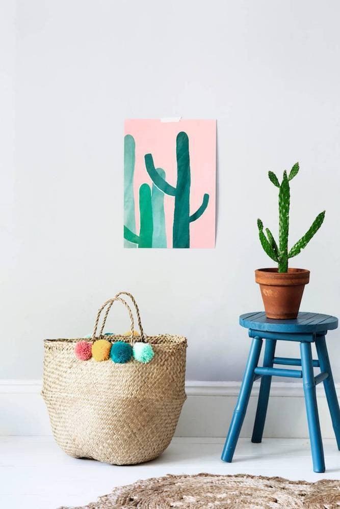 inexpensive home decor ideas pom pom basket in a white room