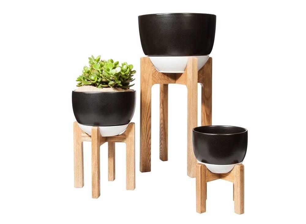 black plant stand wood base