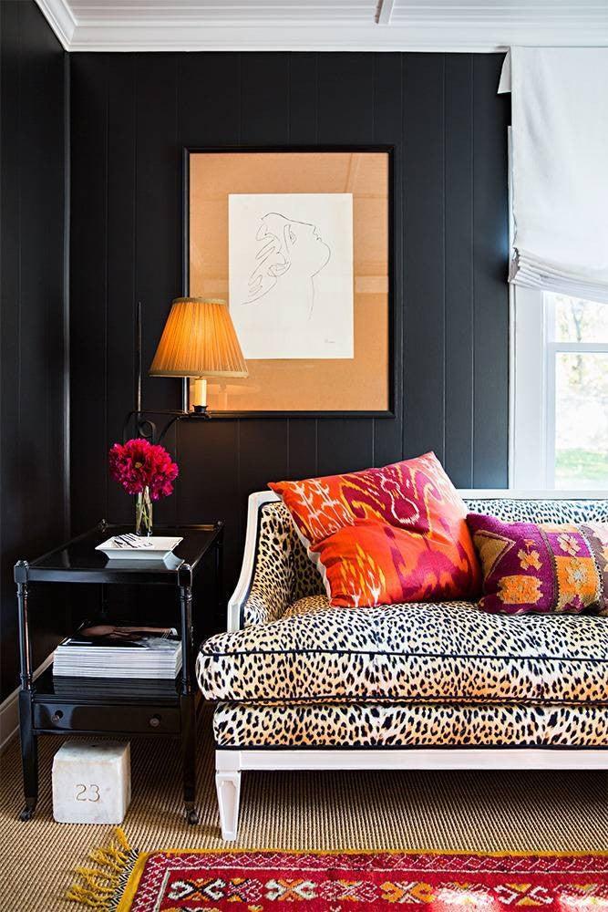 nail color trends black walls and leopard sofa