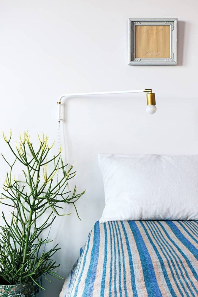 nail color trends white wall bedroom with blue and white striped blanket