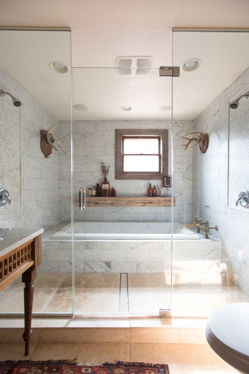 a bathroom decorated in a modern farmhouse theme