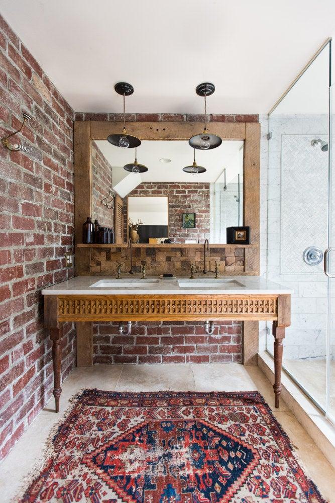 a bathroom designed using mixed materials