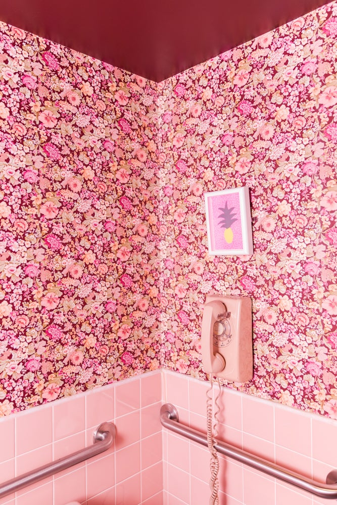 a bathroom designed in an all-pink theme