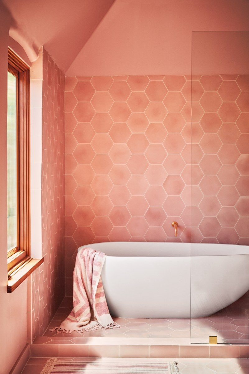 a bathroom designed with hexagon shaped tiles