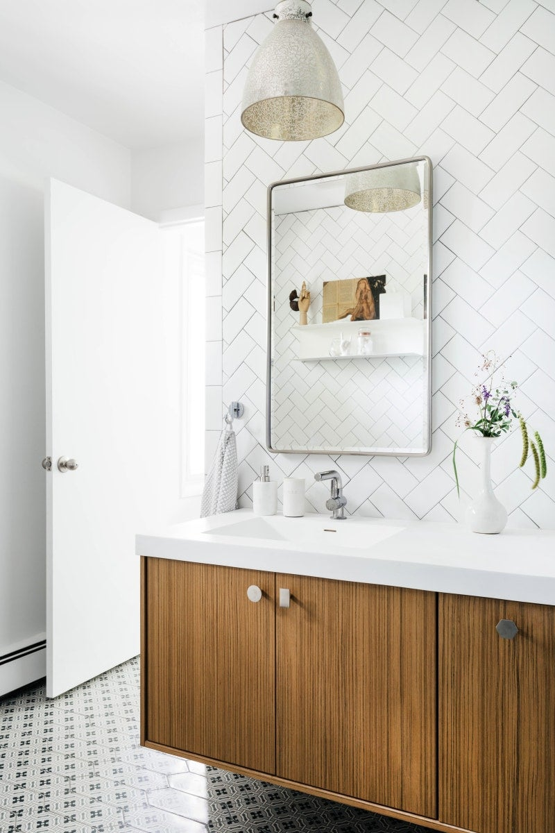 a bathroom designed with mid-century industrial theme