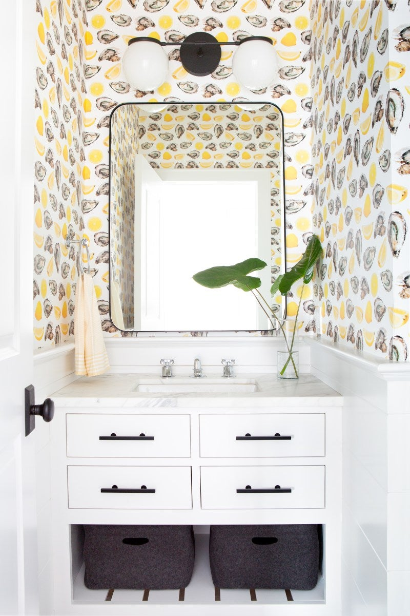a bathroom designed with yellow pattern wallpaper