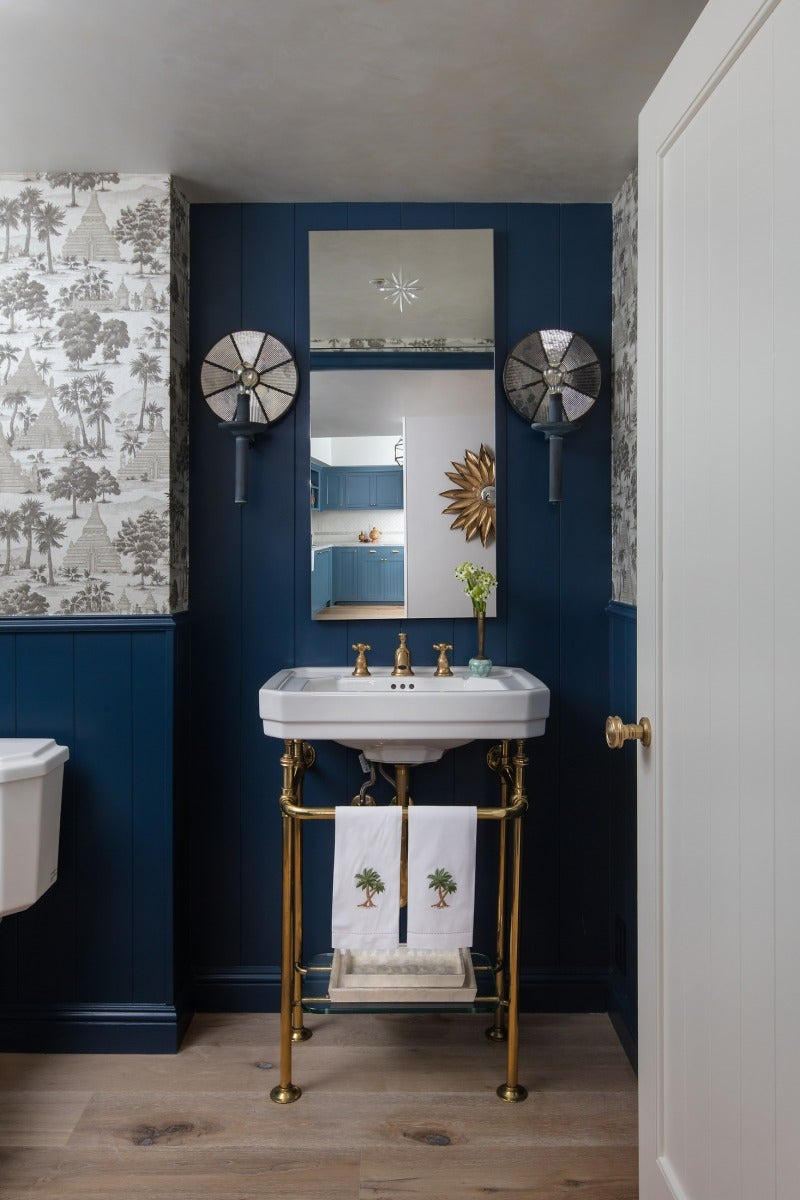 a bathroom decorated with cool blue tones for a tropical feel