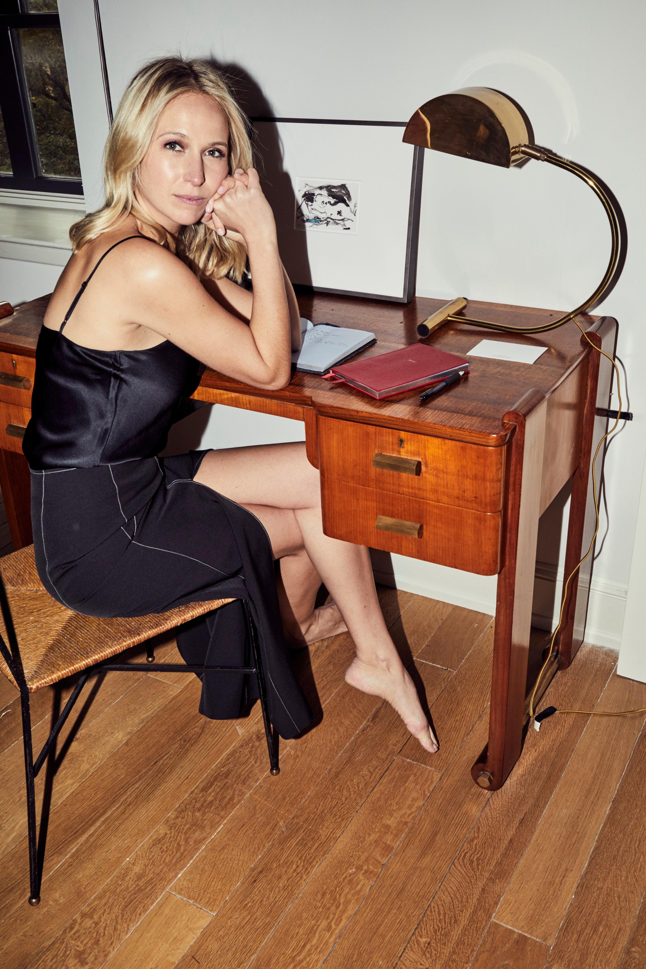Misha at her desk
