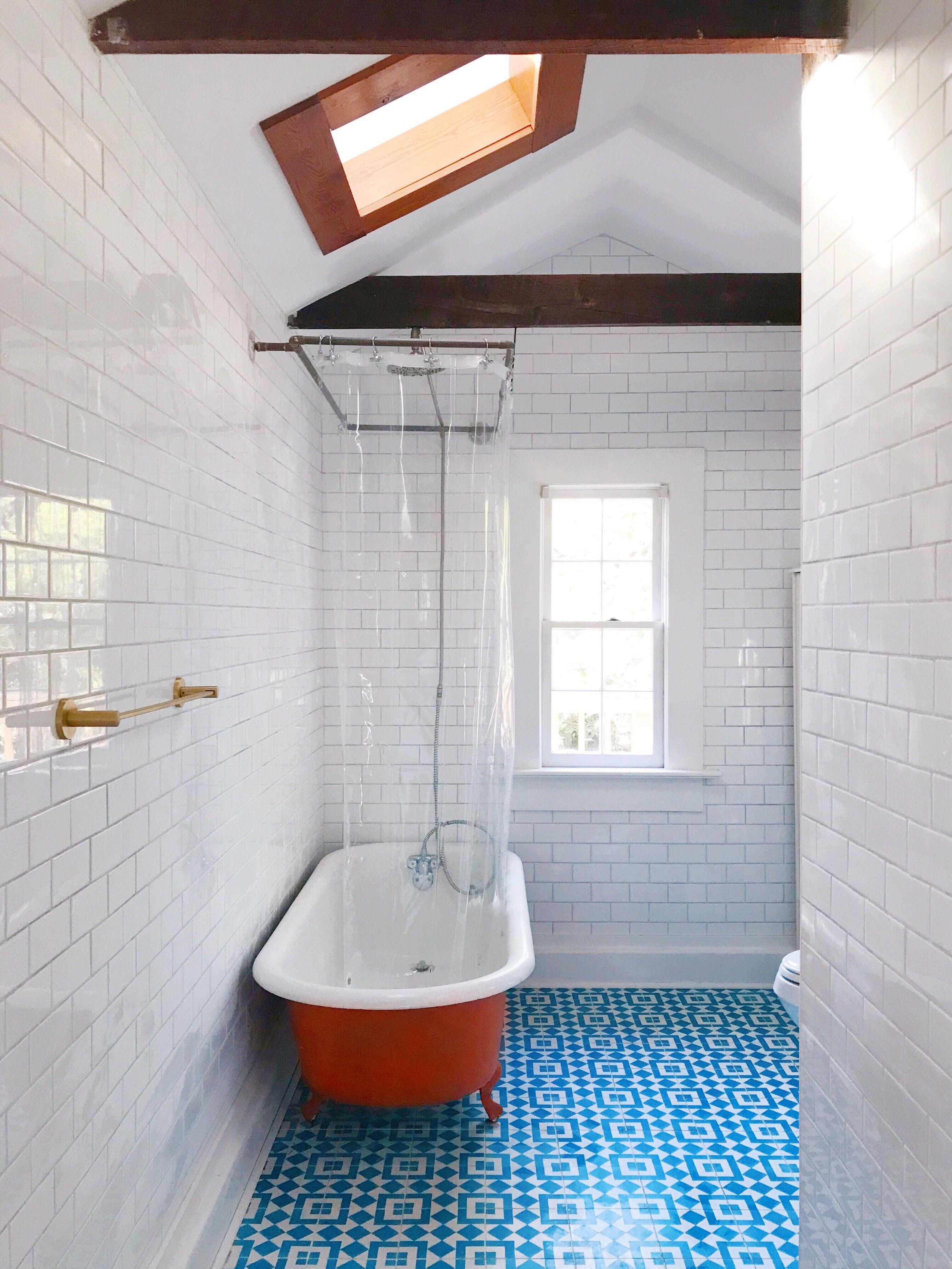 tiled bathroom - subway tiles and mosaic on floor