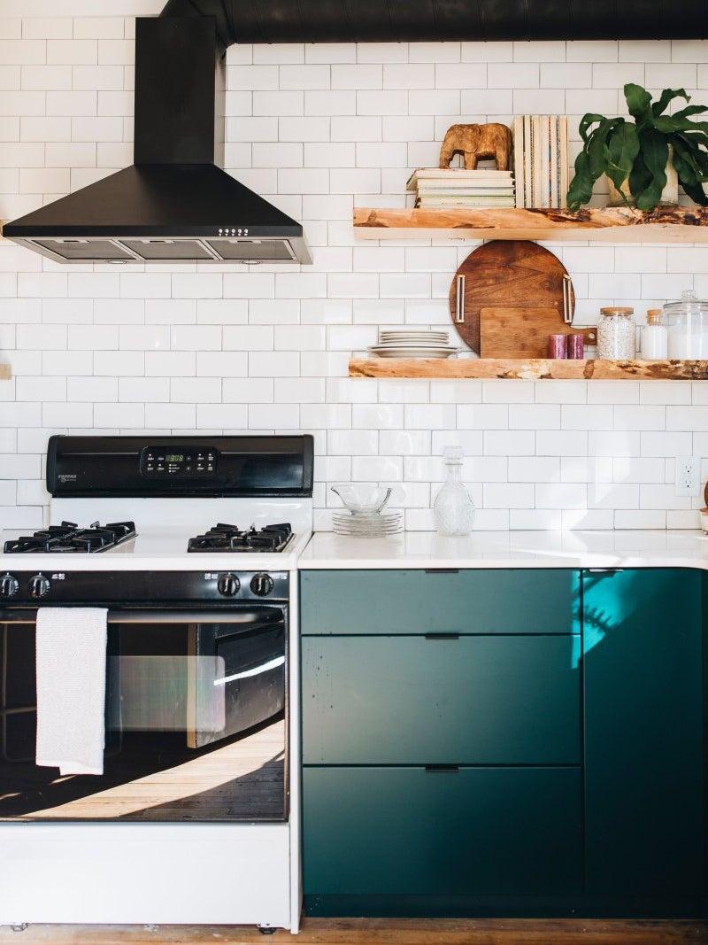 green kitchen with white subway tile