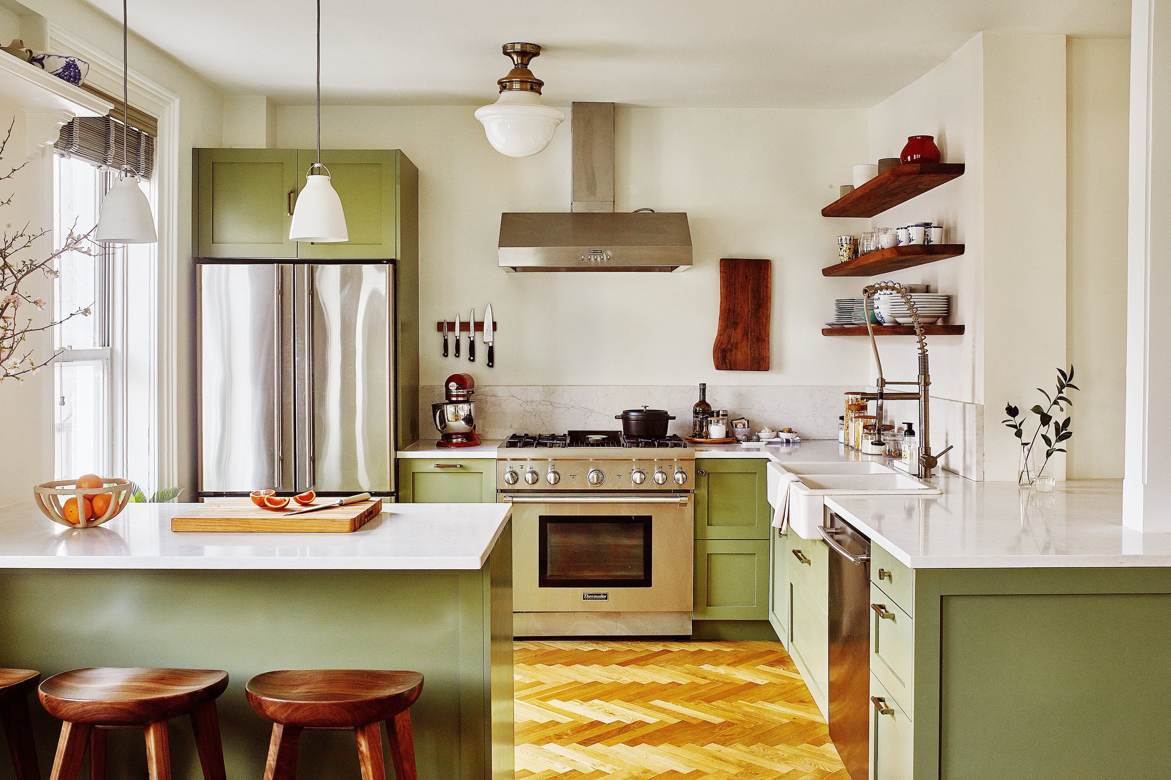 moss green kitchen with small island