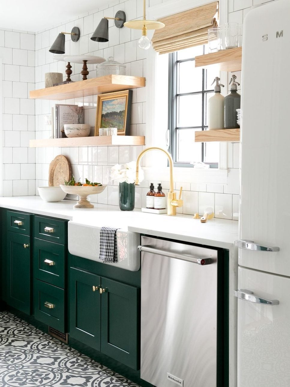 black and white tile kitchen floors with dark green cabinets