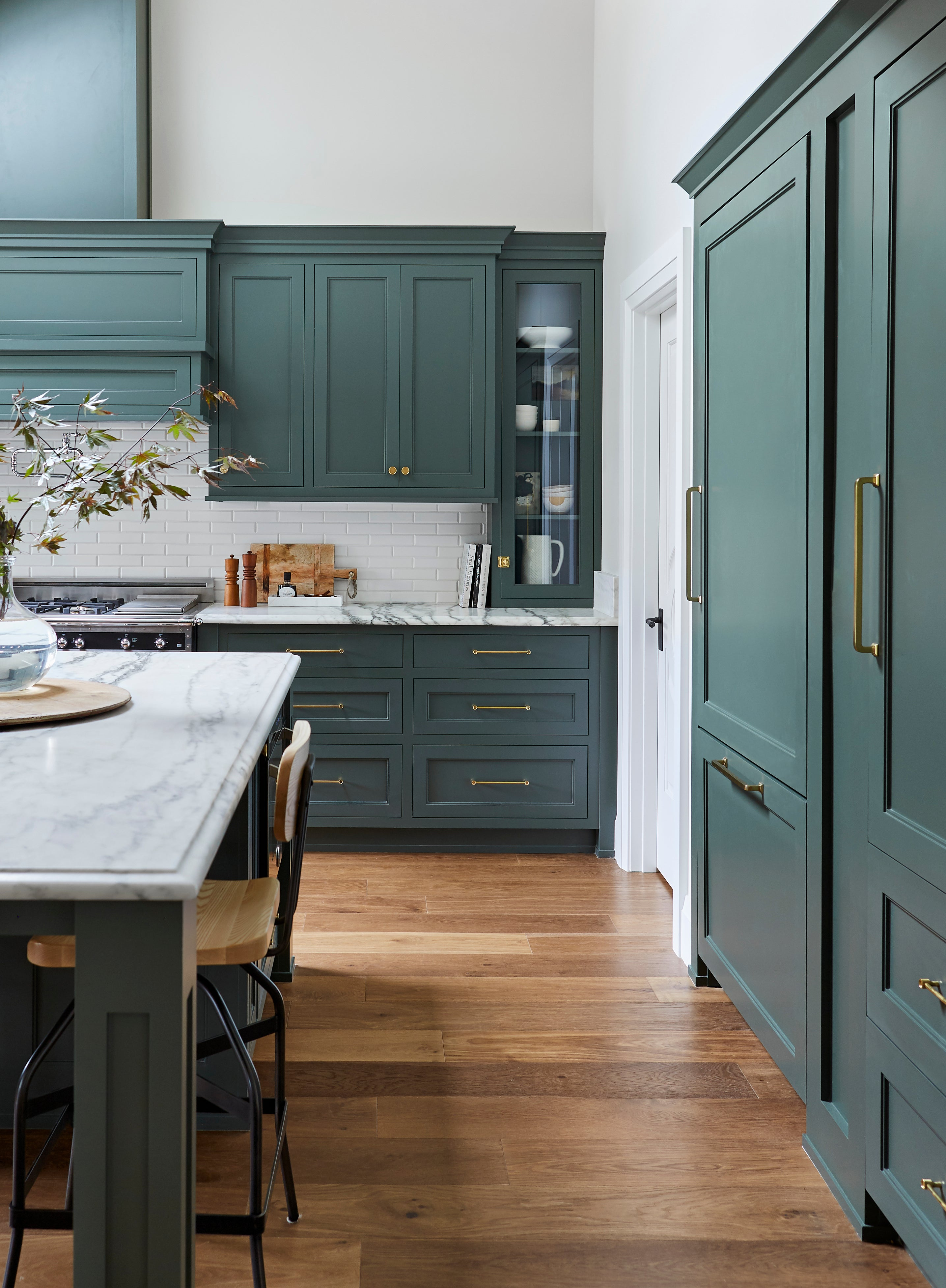 gray green kitchen cabinets with gray marble counters