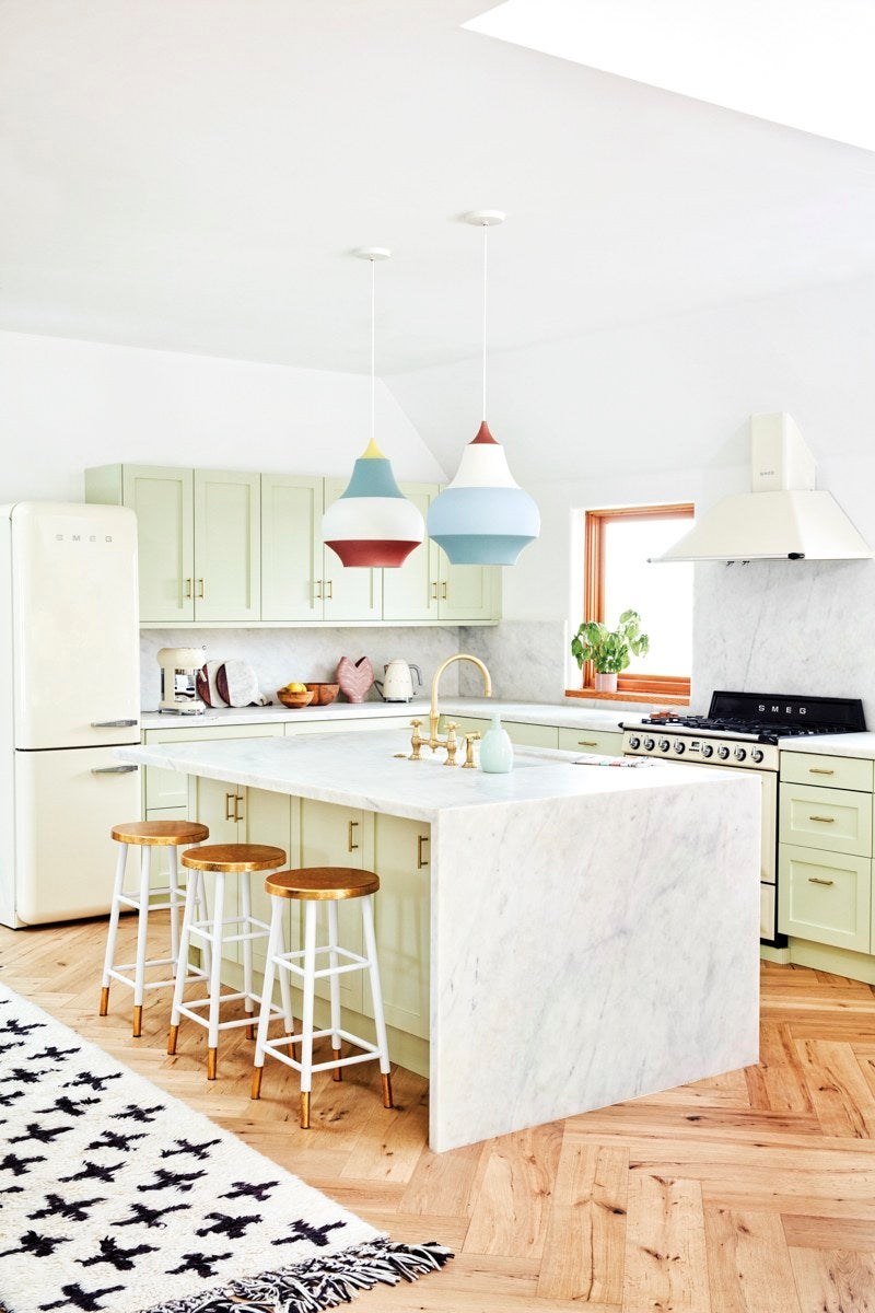 mint green kitchen with colorful pendant lights