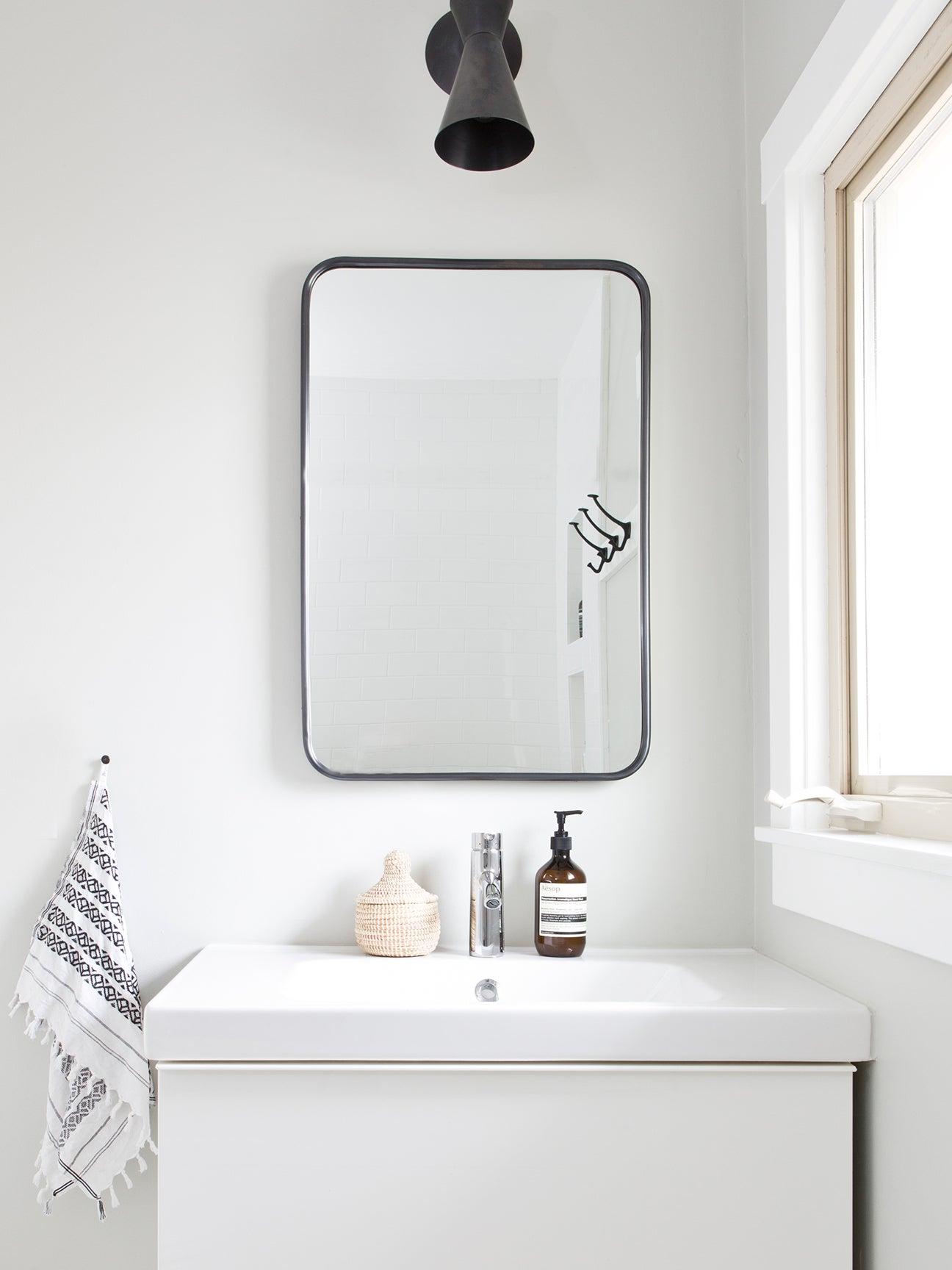 white bathroom with single sink vanity