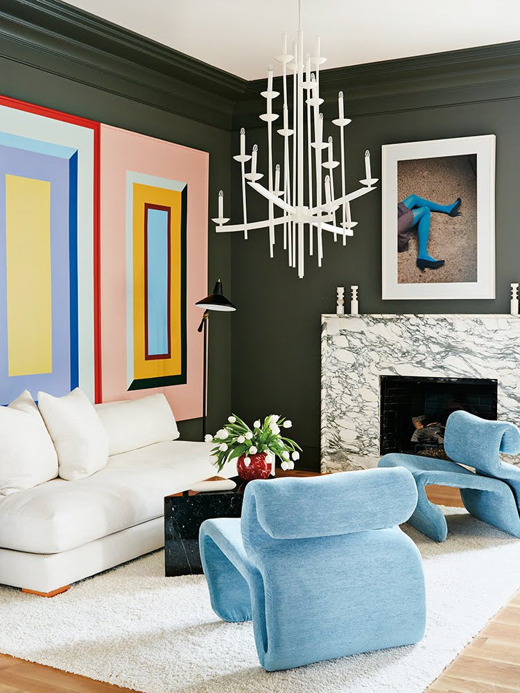 living room with three colorful square murals