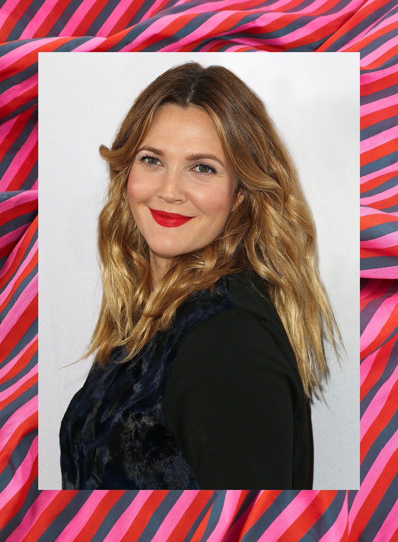 drew barrymore against a pink background