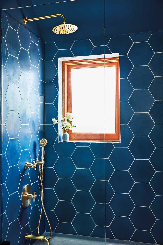 blue bathroom with hexagonal shower tiles