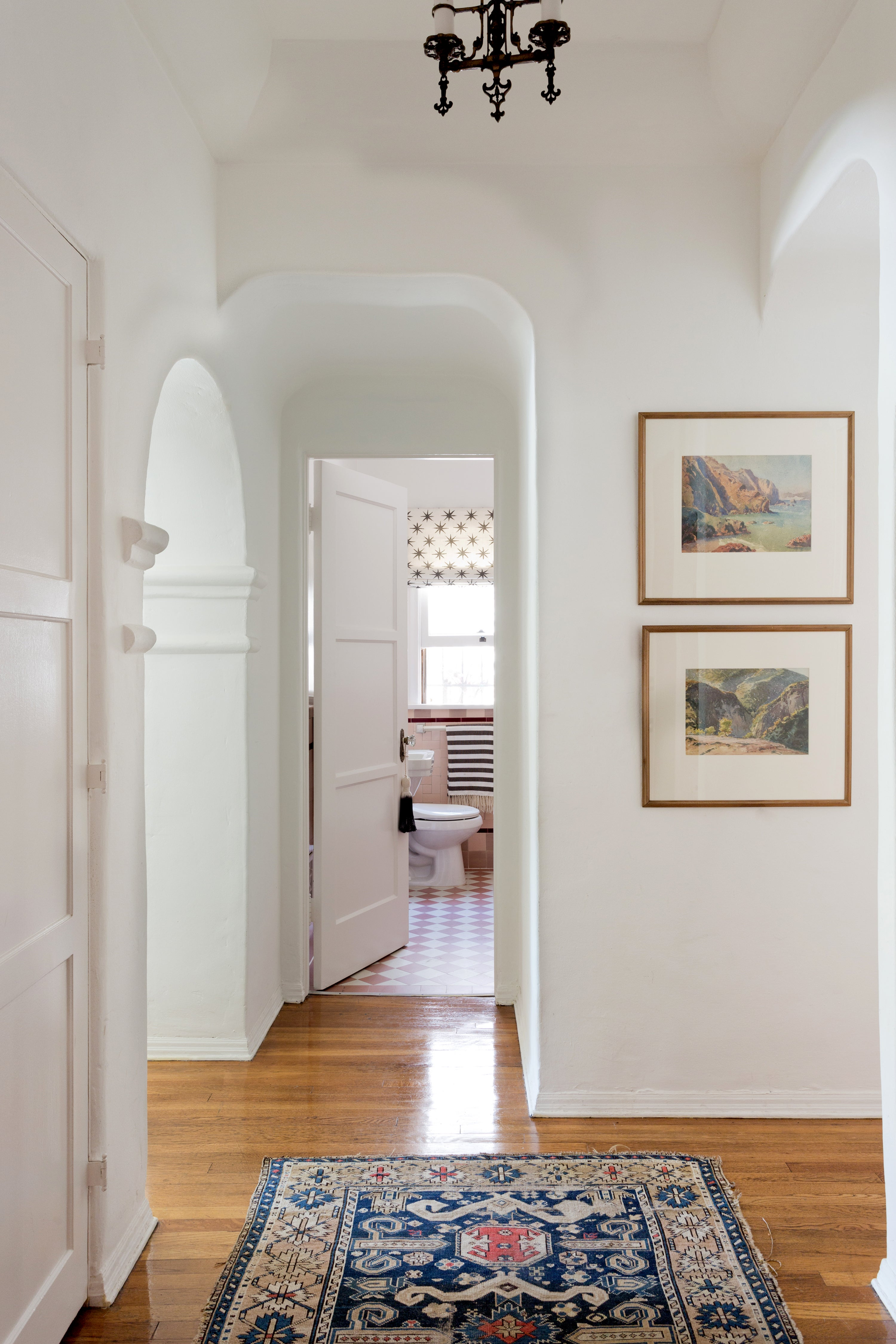 hallway photo wiht white paint and hardwood floors