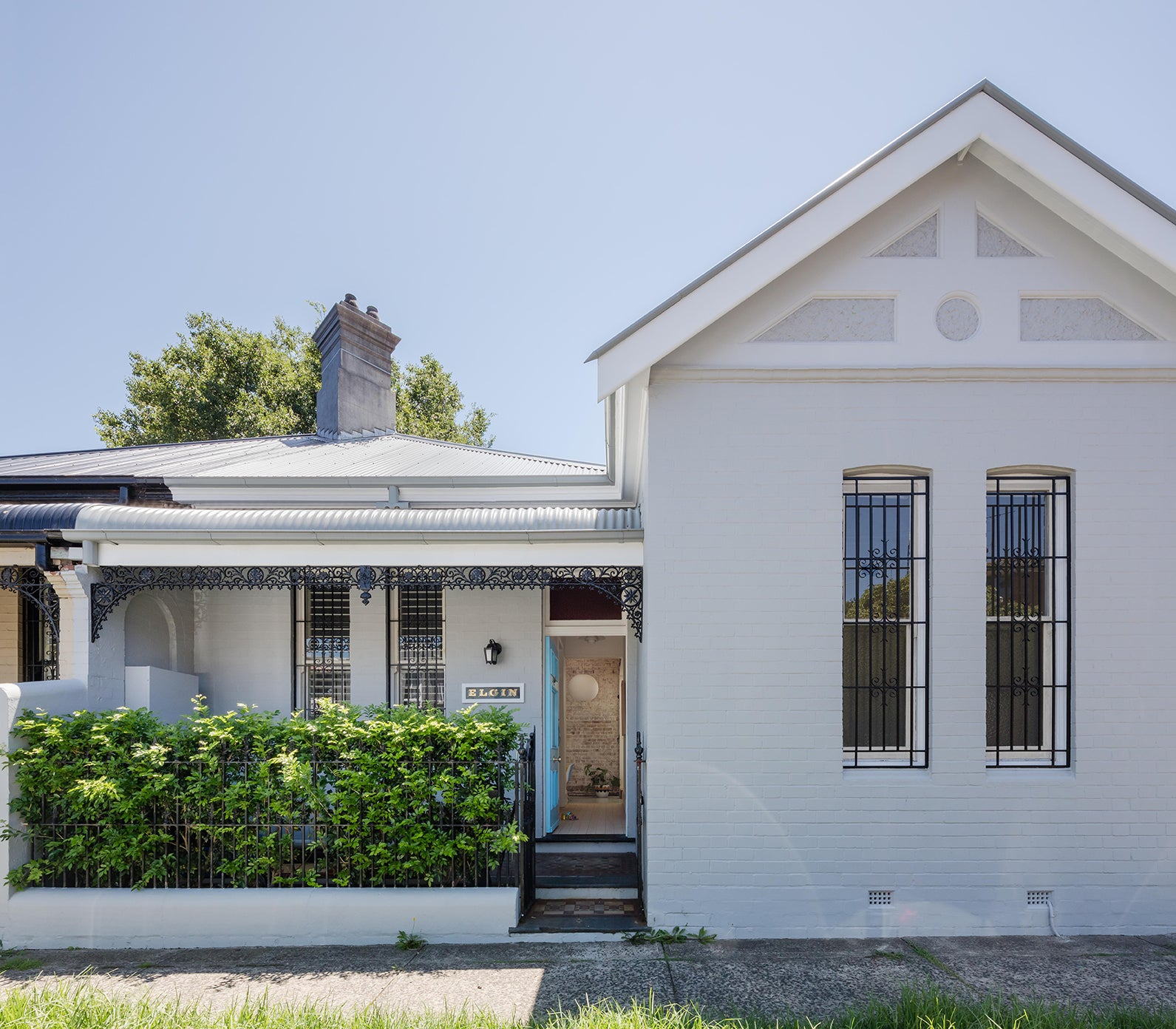 exterior shot of a small white cottage