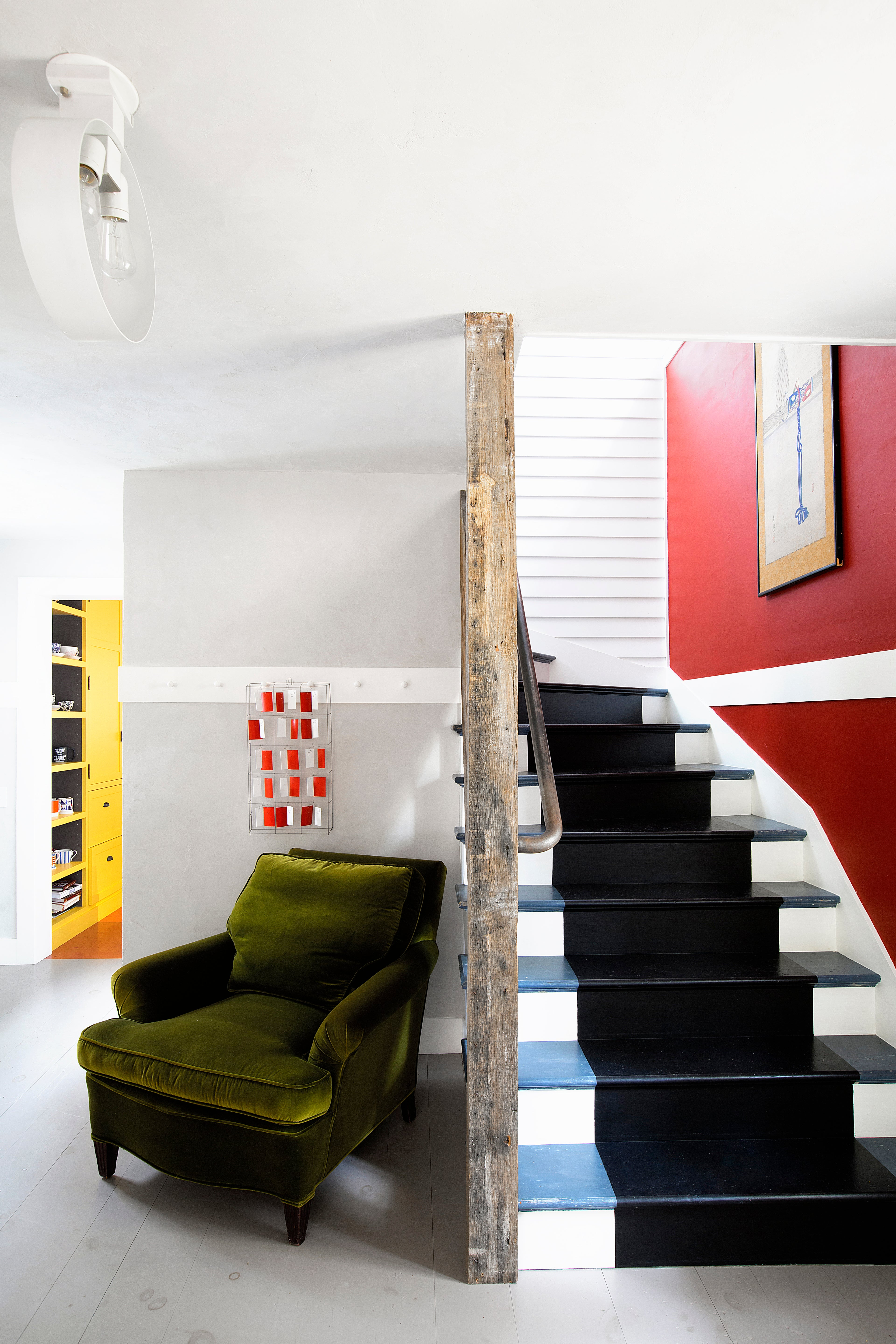 red stairwell with blue and black steps