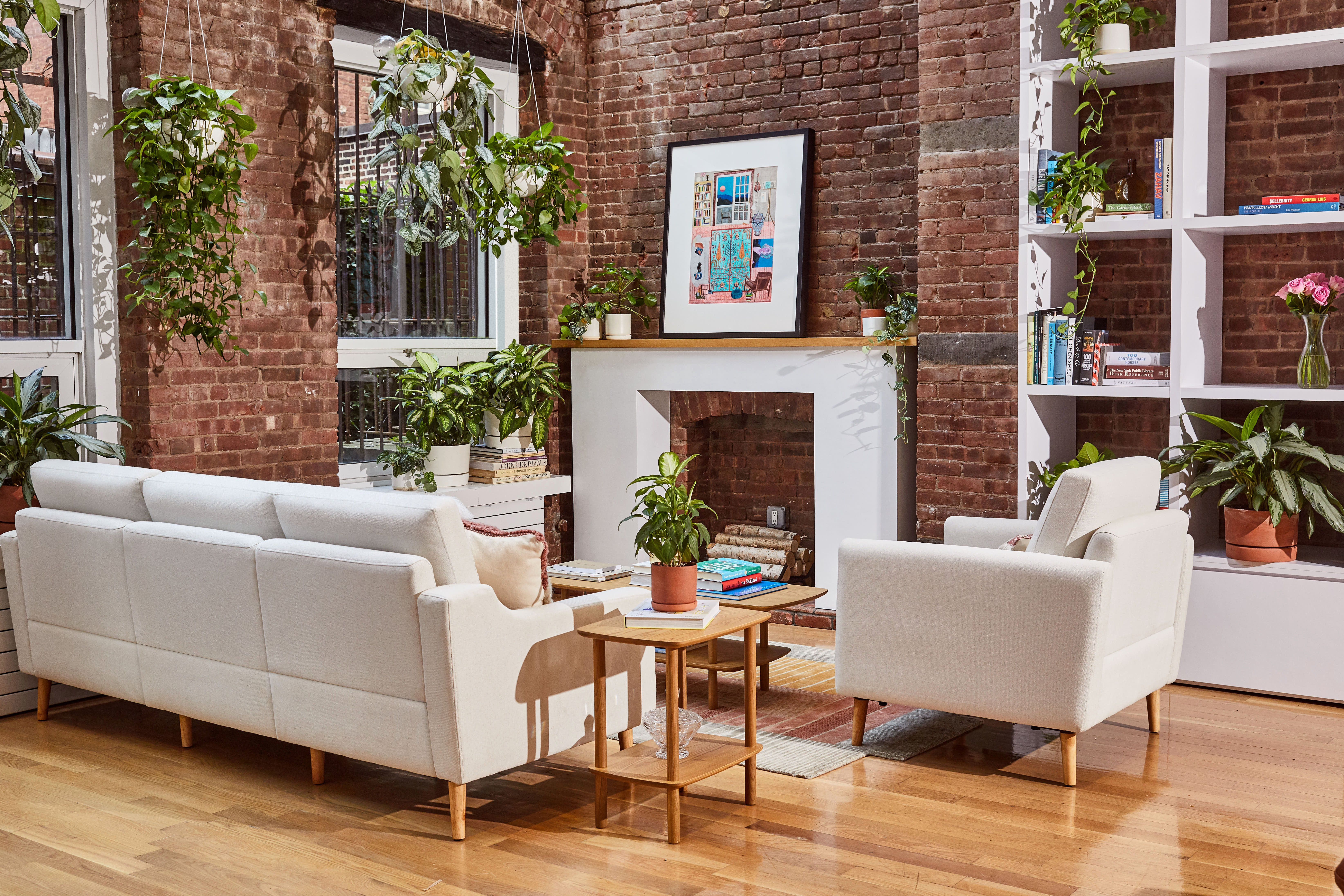 Living room with fire place and brick walls.