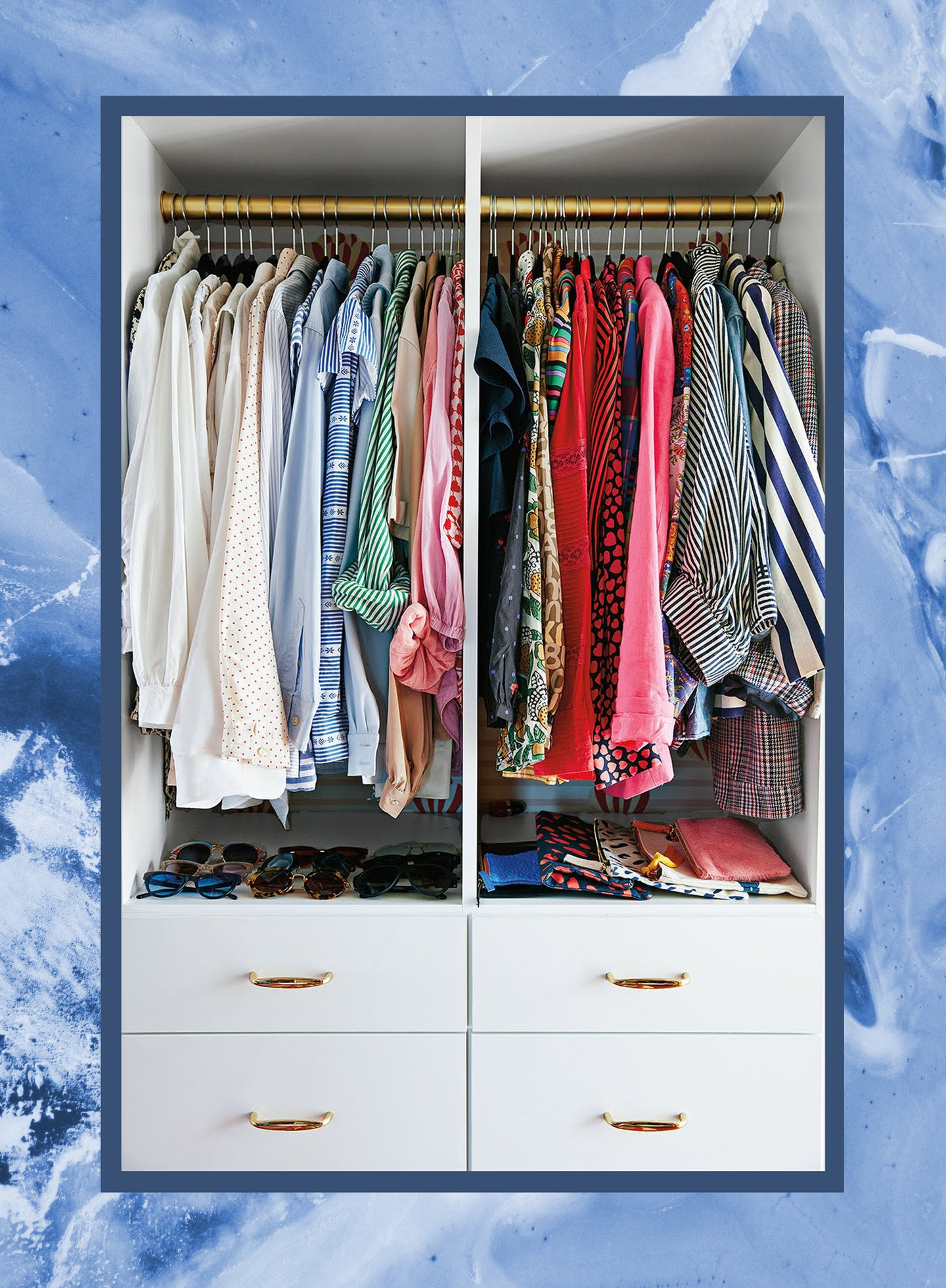 photo of a color coordinated closet on a blue backdrop
