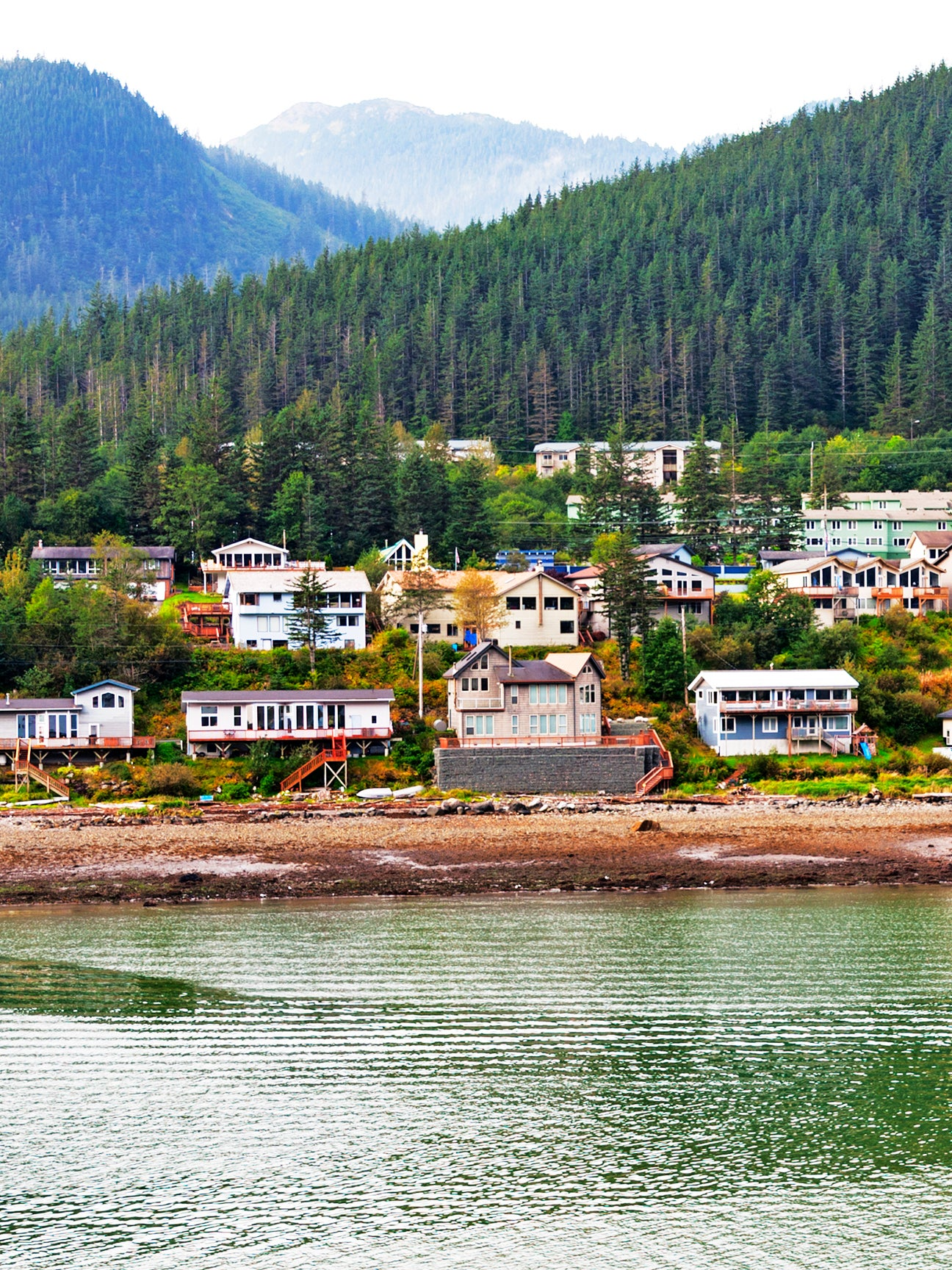 photo of junea alaska by a lake and mountains