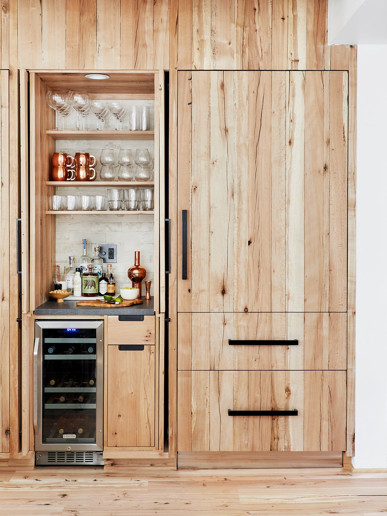 shot of the outside of a wood refrigerator with a bar nook next to it