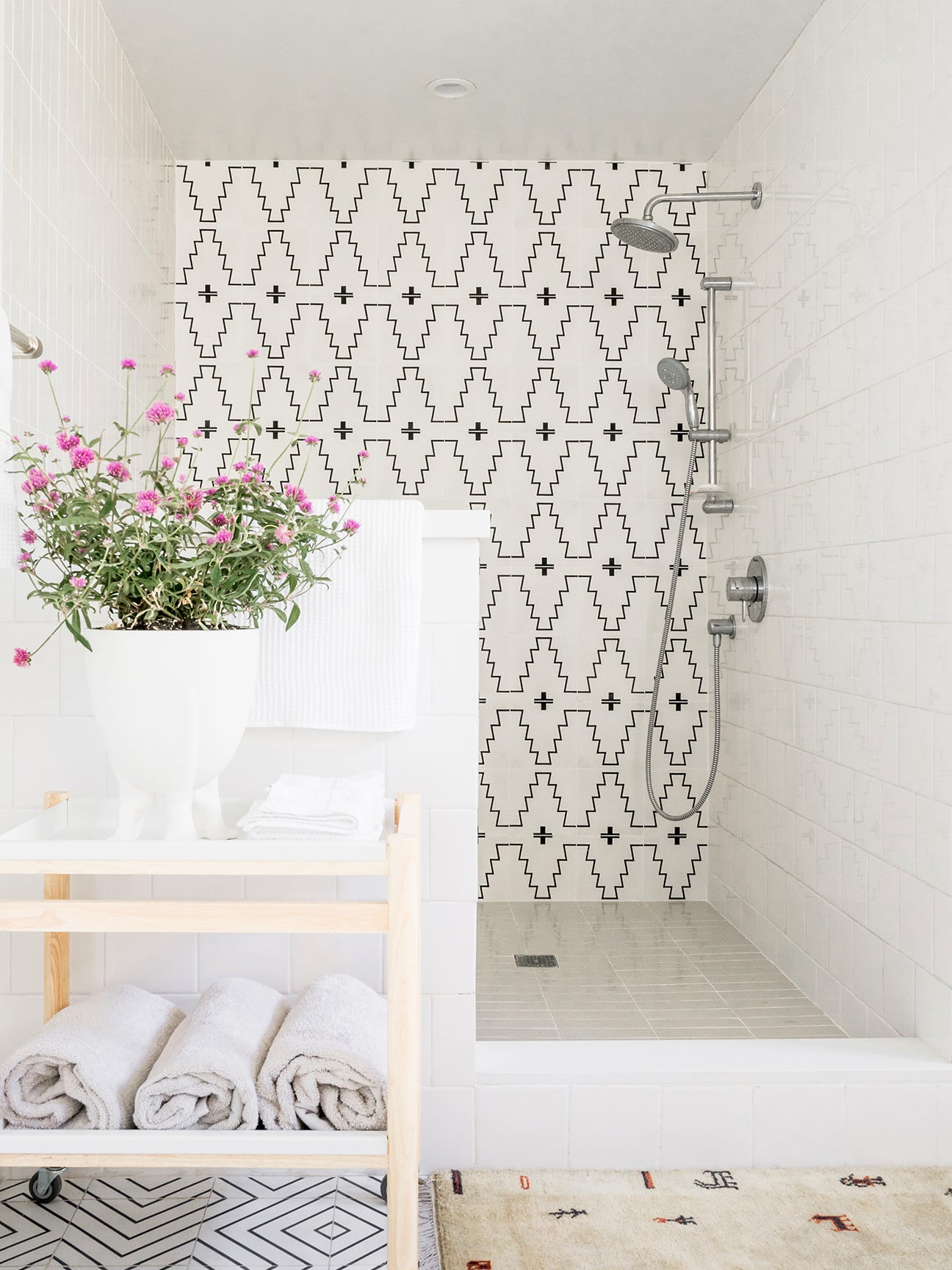 white shower with black and white western tiles
