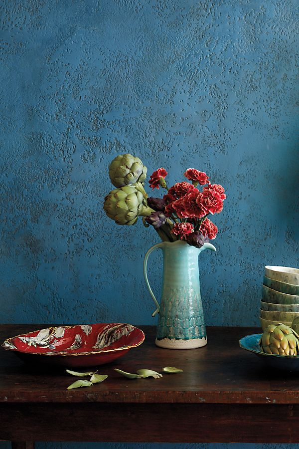 table vignette with peacock blue pitcher filled with flowers