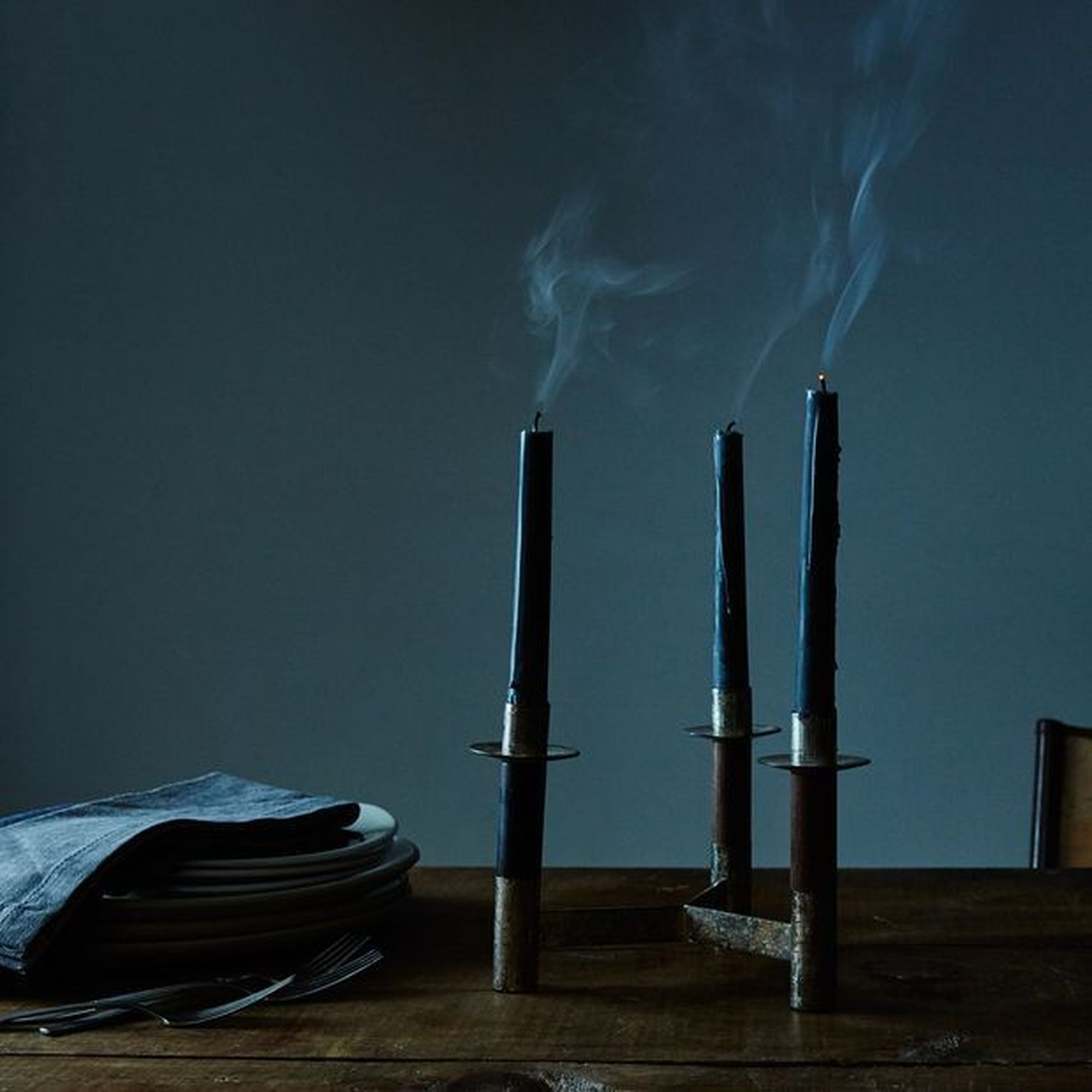 black taper candles on a table