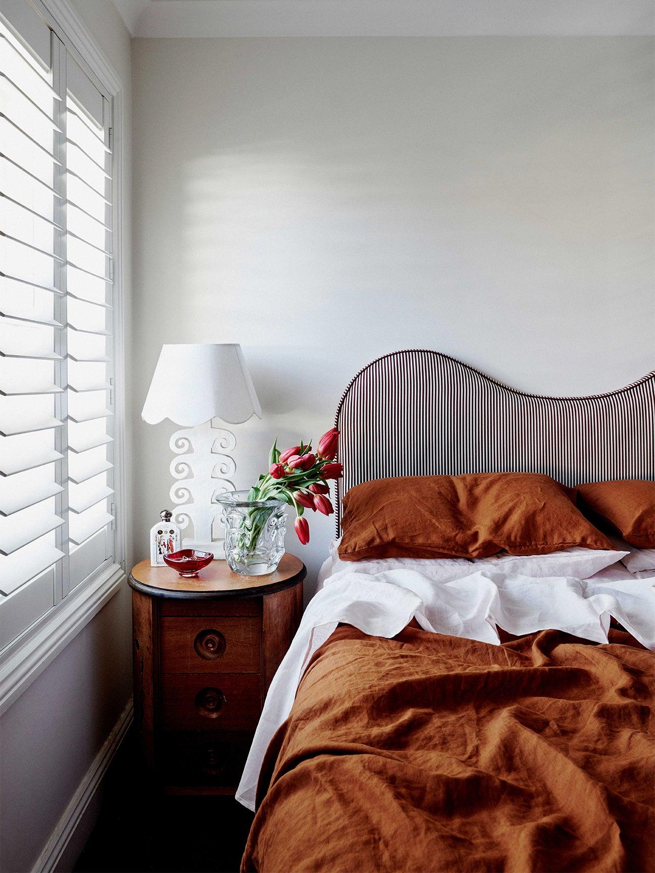 Bedroom with a wavy headboard.