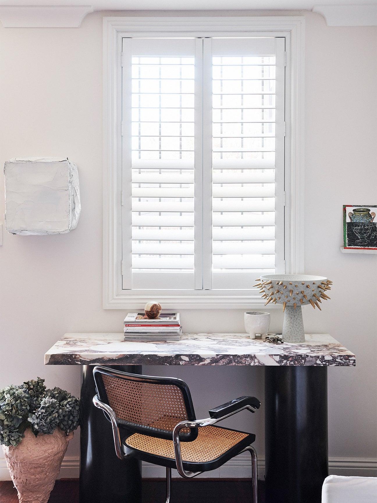Modern desk overlooking a window.