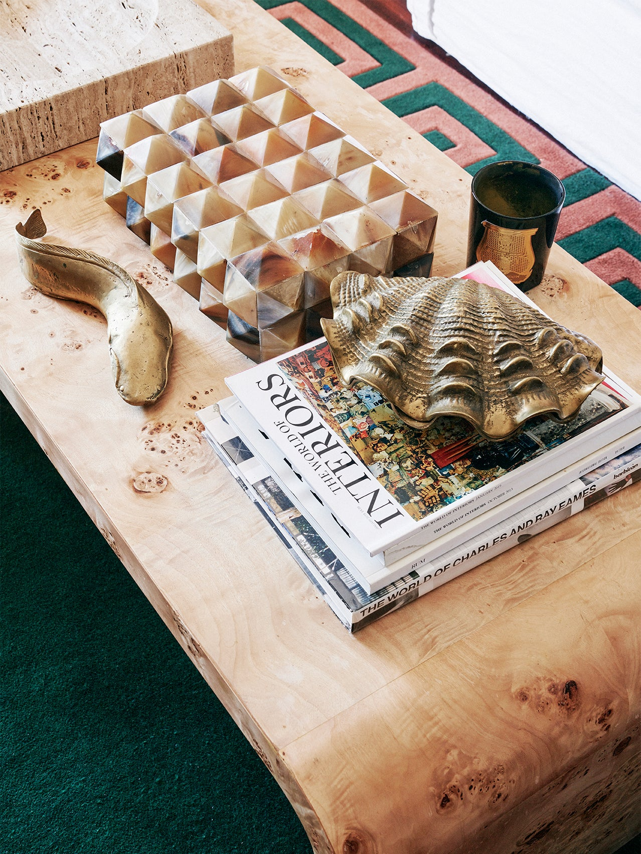 Wooden coffee table with knick-knacks.
