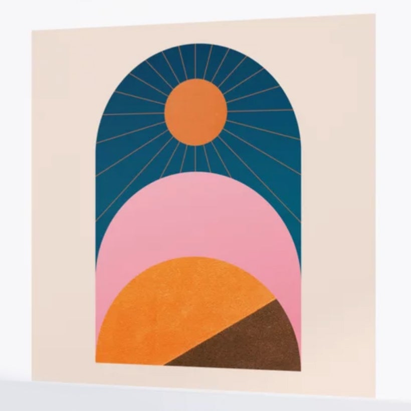 abstract wall mural depicting a sun and mountains
