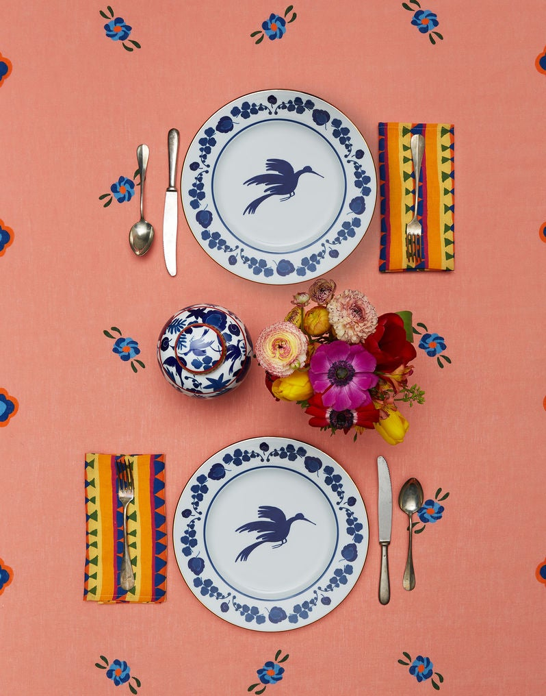 peach table linen with vintage blue plates