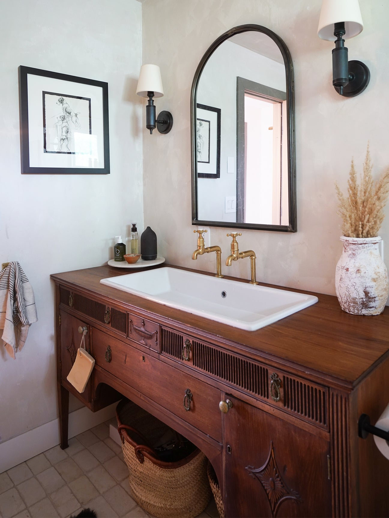 antique table repurposed as a bathroom vanity with a sink