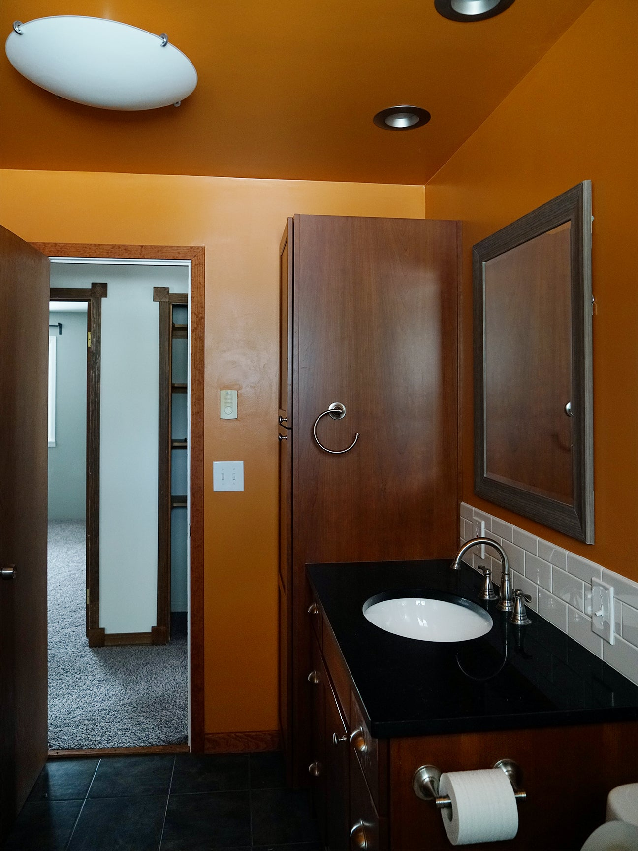 before shot of an orange small master bathroom