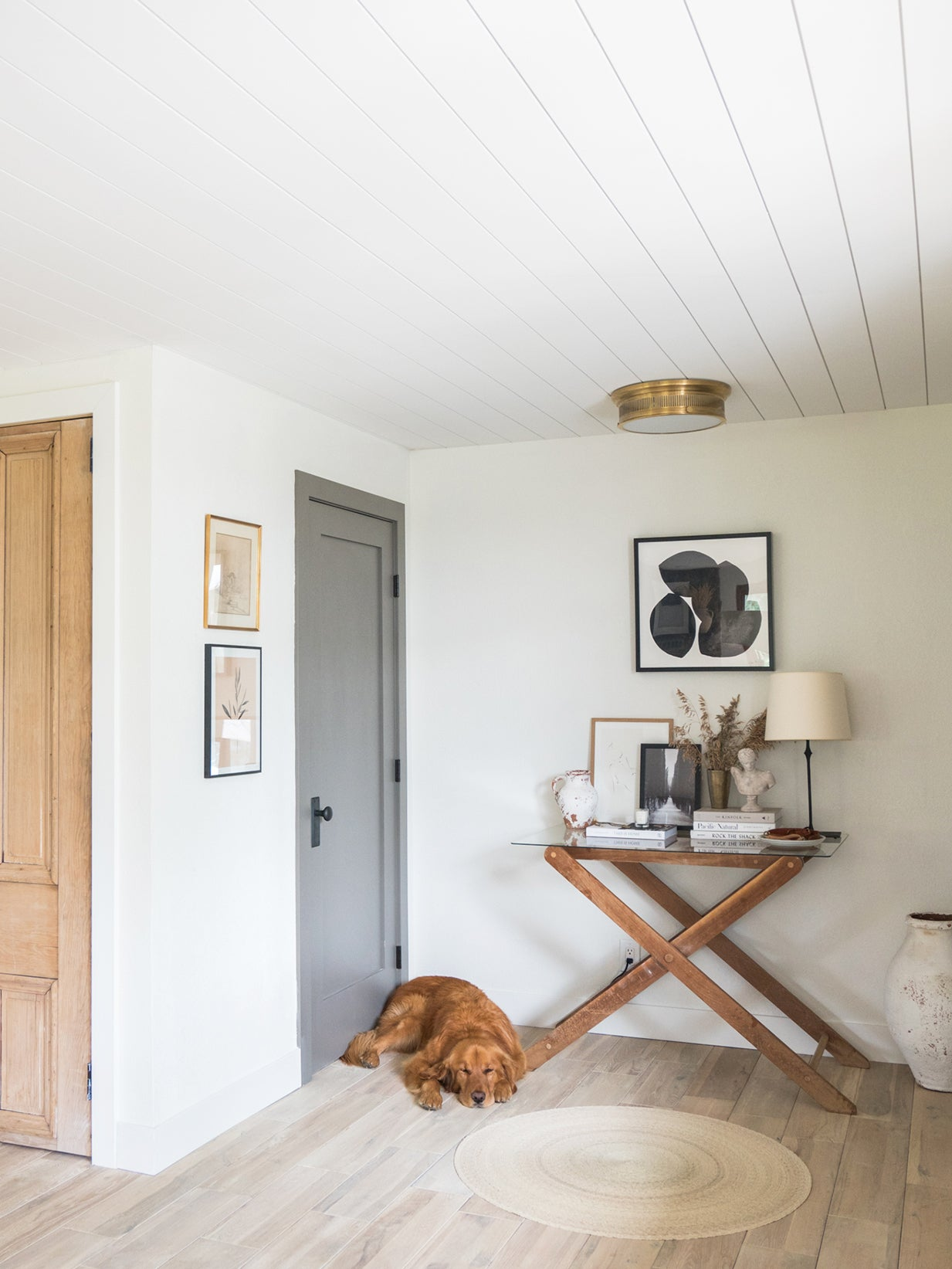dog sleeping next to an x shaped console table