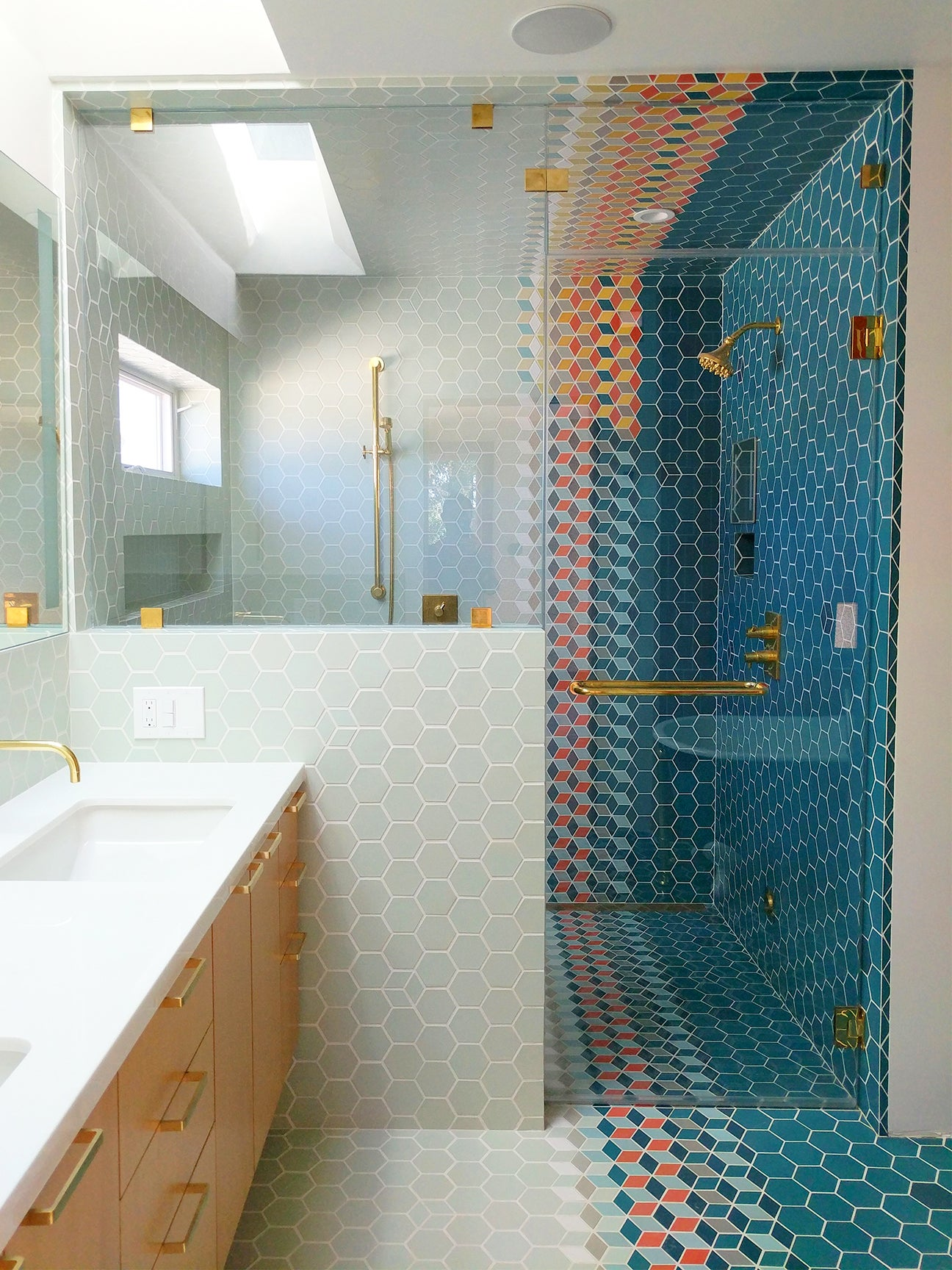 large shower with blue hexagon tiles
