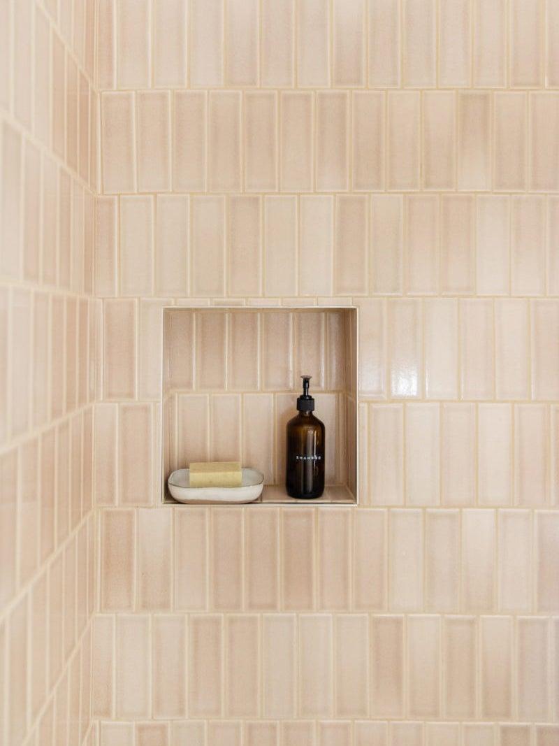 pale pink vertical shower tile