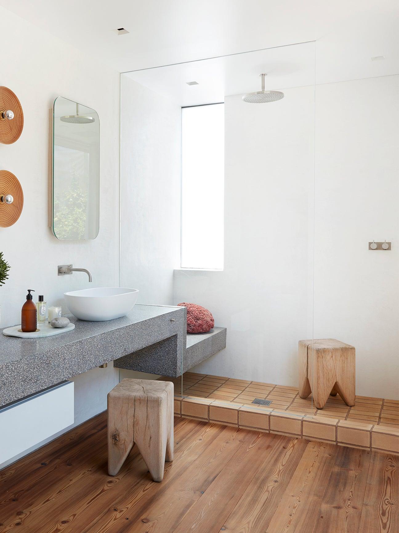 zen shower with terrazzo vanity leading into the shower bench