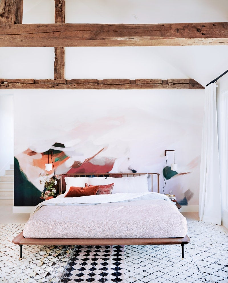 light bedroom with bed and wall mural
